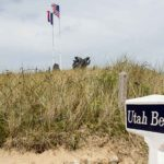 Utah Beach with sign and monument.